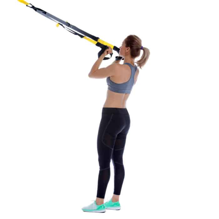 Girl performing TRX Biceps Curl