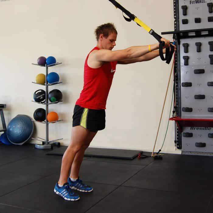 Man performing a TRX Triceps Extension