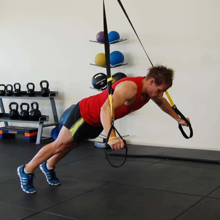 Man performing the TRX fly