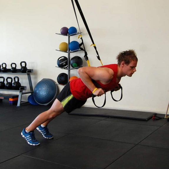 Man performing a TRX Front Squat Jump