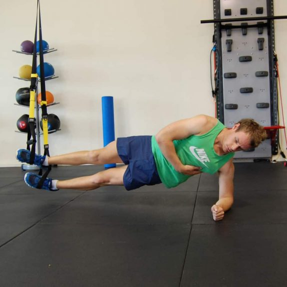 Man performing TRX Side Plank