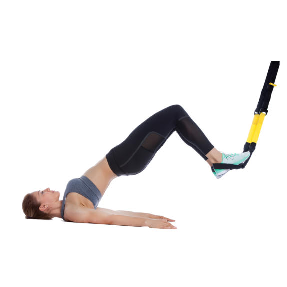 Girl performing a TRX Hamstring curl