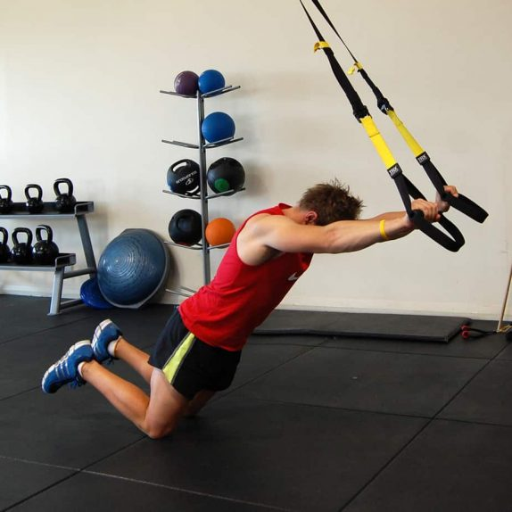 Man performing a TRX Kneeling Rollout
