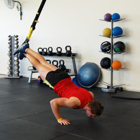 Man performing a TRX push up