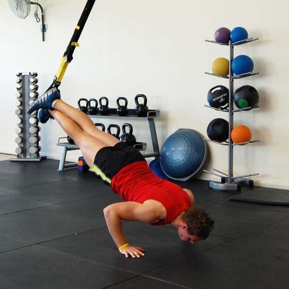 Man performing a TRX push up