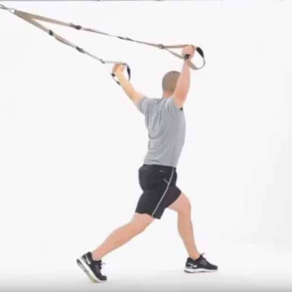 Man performing TRX Split Squat Y Fly